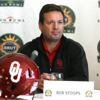 Photo - OU: University of Oklahoma coach Bob Stoops waits for the start of a news conference for the NCAA college football Sun Bowl game on Thursday, Dec. 10, 2009, in El Paso, Texas. Stanford and Oklahoma meet on  Dec. 31, 2009 in El Paso. (AP Photo/El Paso Times, Ruben R Ramirez) ORG XMIT: TXELP101