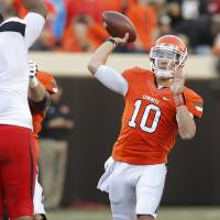 Photo - Oklahoma State's Clint Chelf (10) throws a pass during a college football game between Oklahoma State University (OSU) and Texas Tech University (TTU) at Boone Pickens Stadium in Stillwater, Okla., Saturday, Nov. 17, 2012.  Photo by Bryan Terry, The Oklahoman