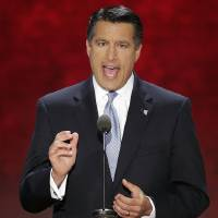Photo - FILE - In this Aug. 28, 2012, photo, Nevada Gov. Brian Sandoval addresses the Republican National Convention in Tampa, Fla.  Sandoval heads into the 2013 legislation session with a pledge to keep the lid on state spending while facing soaring costs for social services, expanding Medicaid and recommending more tax breaks for businesses.  (AP Photo/J. Scott Applewhite)