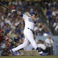 Photo - Los Angeles Dodgers' Andre Ethier follows through on a three-run triple during the fourth inning of a baseball game against the Cincinnati Reds on Tuesday, May 27, 2014, in Los Angeles. (AP Photo/Jae C. Hong)