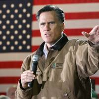 Photo -   FILE - In this Dec. 12, 2011, photo, Republican presidential candidate, former Massachusetts Gov. Mitt Romney gestures during a campaign stop with mill workers at the Madison Lumber Mill in Madison, N.H. Romney is starting to open up. For the past year, the former Massachusetts governor has emphasized his business background as he argued that he should be president because he understands the economy and can fix it to help millions of out-of-work Americans. But Romney, a multimillionaire many times over who critics call robotic, has struggled to connect with average people on the campaign trail. (AP Photo/Jim Cole)