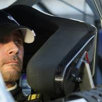 Photo -   Jimmie Johnson looks out of his car following qualifying for the NASCAR Sprint Cup Series auto race, Friday, Nov. 9, 2012, at Phoenix International Raceway in Avondale, Ariz. (AP Photo/Paul Connors)