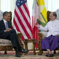 Photo -   FILE - In this Nov. 19, 2012 file photo, U.S. President Barack Obama, left, meets with Myanmar's President Thein Sein at the Yangon Parliament building in Yangon, Myanmar. The United States is unwinding two decades of sanctions against Myanmar, as the country's reformist leadership oversees rapid-fire economic and political change. Obama's visit this week, the first by a serving U.S. president, is a sign of how far relations have come. But Washington continues to take a calibrated approach to easing sanctions, keen to retain leverage should Myanmar's reform momentum stall. (AP Photo/Carolyn Kaster, File)