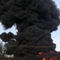 Photo - Burning rubber filters Wednesday at the Wastewater Treatment Plant on Jenkins Avenue near State Highway 9 in Norman caused black smoke to spiral 30 to 40 feet in the air. The fire burned the filters and grass before being contained. PHOTO BY LYNETTE LOBBAN, FOR THE OKLAHOMAN