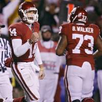 Photo - CELEBRATE / CELEBRATION: Oklahoma's Sam Bradford (14) pumps his fist after throwing a touchdown pass during the first half of the Big 12 Championship college football game between the University of Oklahoma Sooners (OU) and the University of Missouri Tigers (MU) on Saturday, Dec. 6, 2008, at Arrowhead Stadium in Kansas City, Mo.   PHOTO BY BRYAN TERRY, THE OKLAHOMAN  ORG XMIT: KOD