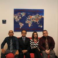 Photo - In this photo taken on March 13, 2014, from left, Alfonso Casares Tafur, Bernardo Montes-Rodriguez, Elizabeth Nino de Rivera, and Francisco Javier Marcano pose for a photo at the offices of SMU's Embrey Human Rights Program in Dallas. They are Garland Independent School District teachers who lost their jobs and residency status. (AP Photo/The Dallas Morning News, Evans Caglage)  MANDATORY CREDIT; MAGS OUT; TV OUT; INTERNET USE BY AP MEMBERS ONLY; NO SALES