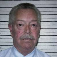 Photo - In this photo provided by the Custer County Sheriff's Department, former Custer County Sheriff Mike Burgess, who faces 35 felony charges including 14 counts of second-degree rape, seven counts of forcible oral sodomy and five counts of bribery by a public official, is pictured in a booking photo. AP Photo