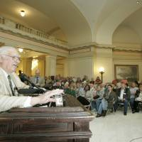 Photo - PROTEST / SENIOR CITIZENS / SENIORS RALLY: Charles Campbell speaks to seniors at the state Capitol who were protesting recent cuts to nutrition programs for the elderly in Oklahoma City, Oklahoma November 4, 2009. Photo by Steve Gooch, The Oklahoman ORG XMIT: KOD