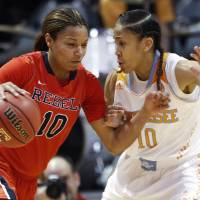 Photo - Mississippi guard Diara Moore (10) drives against Tennessee guard Meighan Simmons (10) during the first half of an NCAA college basketball game Thursday, Jan. 9, 2014, in Knoxville, Tenn. (AP Photo/Wade Payne)