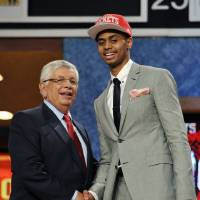 Photo - NBA Commissioner David Stern, left, poses with Jeremy Lamb, of Connecticut, the No. 12 overall draft pick by the Houston Rockets in the NBA basketball draft, Thursday, June, 28, 2012, in Newark, N.J. (AP Photo/Bill Kostroun) ORG XMIT: NJME129