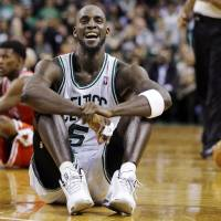 Photo - Boston Celtics forward Kevin Garnett (5) reacts on the court after a floor scramble with Chicago Bulls forward Jimmy Butler (21) during the fourth quarter of an NBA basketball game in Boston, Wednesday, Feb. 13, 2013. The Celtics gained possession of the ball and went on to win 71-69. (AP Photo/Elise Amendola) ORG XMIT: MAEA111