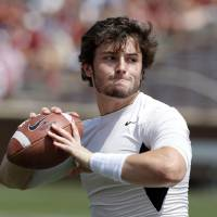 Photo - Baker Mayfield warms up before the Spring College Football Game of the University of Oklahoma Sooners (OU) at Gaylord Family-Oklahoma Memorial Stadium in Norman, Okla., on Saturday, April 12, 2014.  Photo by Steve Sisney, The Oklahoman