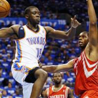 Photo - NBA BASKETBALL: Oklahoma City's Reggie Jackson (15) passes away from Houston's Terrence Jones (6) during Game 1 in the first round of the NBA playoffs between the Oklahoma City Thunder and the Houston Rockets at Chesapeake Energy Arena in Oklahoma City, Sunday, April 21, 2013. Oklahoma City won, 120-91. Photo by Nate Billings, The Oklahoman