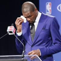 Photo -  Oklahoma City Thunder's Kevin Durant wipes away tears as he speaks during a news conference to announce that Durant is the winner of the 2013-14 Kia NBA Basketball Most Value Player Award in Oklahoma City, Tuesday, May 6, 2014. (AP Photo/Sue Ogrocki)
