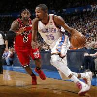 Photo -  Oklahoma City's Kevin Durant (35) goes past Miami's LeBron James (6) during an NBA basketball game between the Oklahoma City Thunder and the Miami Heat at Chesapeake Energy Arena in Oklahoma City, Thursday, Feb. 15, 2013. Photo by Bryan Terry, The Oklahoman