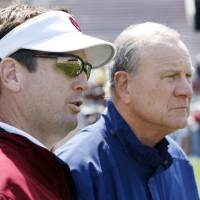 Photo -  Former head coach Barry Switzer and current head coach Bob Stoops (left) watch before the University of Oklahoma football team scrimages at Gaylord Family Oklahoma Memorial Stadium in Norman, Okla., Saturday, April 5, 2008   BY STEVE SISNEY
