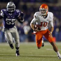 Photo - Oklahoma State's Clint Chelf (10) scrambles as Kansas State's Adam Davis (55) chases him down during the college football game between Kansas State University (KSU) and Oklahoma State (OSU) at  Bill Snyder Family Football Stadium in Manhattan, Kan.,  Saturday, Nov. 3, 2012. Photo by Sarah Phipps, The Oklahoman