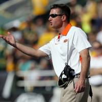 Photo - OSU head coach Mike Gundy talks to an official during a college football game between the Oklahoma State University Cowboys (OSU) and the Baylor University Bears at Floyd Casey Stadium in Waco, Texas, Saturday, Dec. 1, 2012. Photo by Nate Billings, The Oklahoman