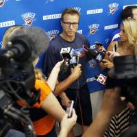 Photo - Head coach Scott Brooks speaks during media availability after practice for the Oklahoma City Thunder NBA basketball team in Oklahoma City, Wednesday, April 23, 2014. Photo by Nate Billings, The Oklahoman