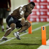 Photo - Sooner running back Roy Finch goes through timed drills as the University of Oklahoma holds Pro Day at the Everest Training Center in Norman, Okla., on Wednesday, March 12, 2014. Photo by Steve Sisney, The Oklahoman