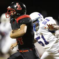 Photo - Luther's Seth Stivers runs past Millwood's Stanford Rice during a high school football game between Luther and Millwood in Luther, Okla., Friday, Sept. 30, 2011. Photo by Bryan Terry, The Oklahoman