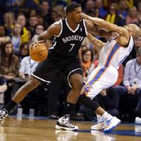 Photo - Brooklyn's Joe Johnson (7) gets an offensive foul pushing Thunder's Derek Fisher in the second half of an NBA basketball game where the Oklahoma City Thunder were defeated 95-93 by the Brooklyn Nets at the Chesapeake Energy Arena in Oklahoma City, on Thursday, Jan. 2, 2014. Photo by Steve Sisney, The Oklahoman