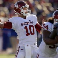 Photo -  OU's Blake Bell (10) throws a pass during the college football game between the University of Oklahoma Sooners (OU) and the University of Kansas Jayhawks (KU) at Memorial Stadium in Lawrence, Kan., Saturday, Oct. 19, 2013. Oklahoma won 34-19. Photo by Bryan Terry, The Oklahoman