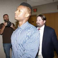 Photo -  University of Oklahoma freshman Joe Mixon and his attorneys walk into Judge Steve Stice's courtroom in Cleveland County in Norman, Monday August 18, 2014.    Steve Gooch -  The Oklahoman