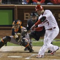 Photo - St. Louis Cardinals' Matt Holliday hits an RBI single during the first inning of Game 4 of baseball's National League championship series against the San Francisco Giants Thursday, Oct. 18, 2012, in St. Louis. (AP Photo/Mark Humphrey)  ORG XMIT: NLCS130
