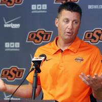 Photo -   Oklahoma State head coach Mike Gundy answers a question during an NCAA college football news conference in Stillwater, Okla., Monday, Sept. 24, 2012. Gundy believes injured starting quarterback Wes Lunt could return to practice by the end of this week, although he's still uncertain whether he'll be able to play in Saturday night's game against Texas. (AP Photo/Sue Ogrocki)