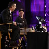 Photo - San Francisco 49ers head coach Jim Harbaugh and Baltimore Ravens head coach John Harbaugh participate in a news conference for the NFL Super Bowl XLVII football game Friday, Feb. 1, 2013, in New Orleans. (AP Photo/Mark Humphrey)