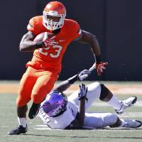 Photo - Oklahoma State's Rennie Childs (23) runs past TCU's Marcus Mallet (54) during a college football game between the Oklahoma State University Cowboys (OSU) and the Texas Christian University Horned Frogs (TCU) at Boone Pickens Stadium in Stillwater, Okla., Saturday, Oct. 19, 2013. Photo by Chris Landsberger, The Oklahoman