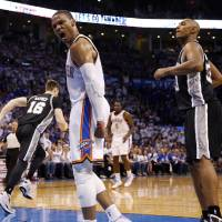 Photo - Oklahoma City's Russell Westbrook (0) celebrates a dunk in front of San Antonio's Boris Diaw (33) during Game 4 of the Western Conference Finals in the NBA playoffs between the Oklahoma City Thunder and the San Antonio Spurs at Chesapeake Energy Arena in Oklahoma City, Tuesday, May 27, 2014. Photo by Nate Billings, The Oklahoman