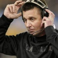 Photo - Oklahoma State head coach Mike Gundy adjusts his headset during the second half of the Cotton Bowl NCAA college football game against Missouri, Saturday, Jan. 4, 2014, in Arlington, Texas. Missouri won 41-31. (AP Photo/Brandon Wade)