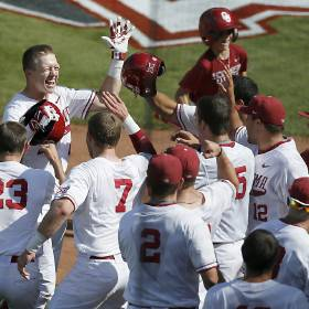 OU\'s Austin O\'Brien celebrates a home run in the bottom of the 4th inning during Big 12...