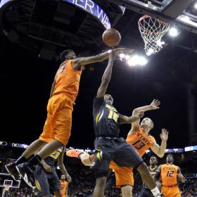 Missouri's Wes Clark (15) gets past Oklahoma State's Leyton Hammonds (23) and Phil Forte III (13) for a shot during the first half of an NCAA college basketball game Tuesday, Dec. 30, 2014, in Kansas City, Mo. (AP Photo/Charlie Riedel)