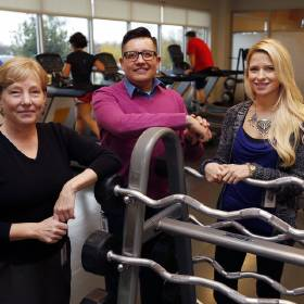 Melton Truck Lines employees Mary Gosnell, left, Hugo Botello and Shayla Williams pose in the on-site gym at the company's new headquarters. [PHOTO BY PAUL HELLSTERN, THE OKLAHOMAN]