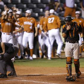 Texas celebrates behind Oklahoma State\'s Collin Theroux (16) after scoring in the eighth...