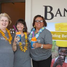 With shaved ice tropical drinks, Bank2 employees toast to raising $40,000 for the Water4 Foundation, an Oklahoma City-based organization committed to eradicating the world's water crisis. Employees will travel to Uganda in January to help drill water wells. PHOTO PROVIDED