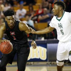 Mustang\'s Jakolby Long (1) drives against Norman North\'s Marcus Dickinson Jr. (5) during a...