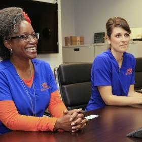 Option One specialty pharmacy Director of Nursing Iris Hall, left, and pharmacist Holly Roper talk about their company.[Photo by Paul Hellstern, The Oklahoman]