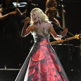 Carrie Underwood performs on stage at the 55th annual Grammy Awards in 2013 in Los Angeles. The Checotah native will return to the Grammy stage Monday to perform a duet with country up-and-comer Sam Hunt. [Photo by John Shearer/Invision/AP]