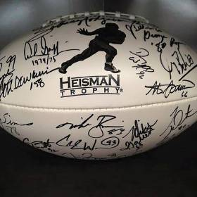 This football autographed by 23 Heisman Trophy winners is being raffled off this week with all proceeds benefiting Dover Public Schools. Photo provided
