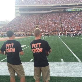 Oklahoma State football support staff wear shirts honoring former video coordinator Jeff Caple on the sidelines in Austin, Texas. / Photo by Kyle Fredrickson
