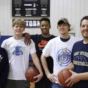 From left, basketball players Tanner Fike, Mark Malone, Tevin Townsend, Kole Talbott and Coach Kurt Talbott pose for a photograph in the gym at the Church of the Harvest in northeast Oklahoma City on Monday, March 16, 2015. Oklahoma City Storm homeschool basketball team won another national title over the weekend. But it was what they did at the end of their blowout victory in the title game that has folks buzzing. The Storm enabled a disabled player from the opposing team to get to the free throw line and score a couple points. They Photo by Jim Beckel, The Oklahoman