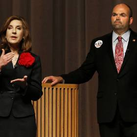 Republican nominee for state schools superintendent Joy Hofmeister, left, speaks as Democratic nominee John Cox listens during a candidate forum Tuesday at Westmoore High School in Moore.                                        Photo by Bryan Terry, The Oklahoman
