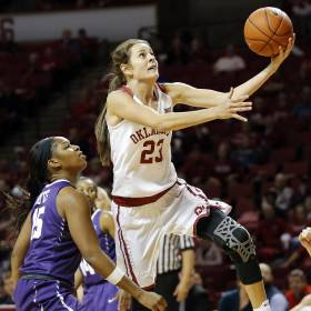 Oklahoma's Maddie Manning (23) takes the ball to the basket past TCU's Jada Butts (15) during a women's college basketball game between the Oklahoma Sooners and the TCU Horned Frogs at Lloyd Noble Center in Norman, Okla., Saturday, Feb. 6, 2016. Photo by Nate Billings, The Oklahoman