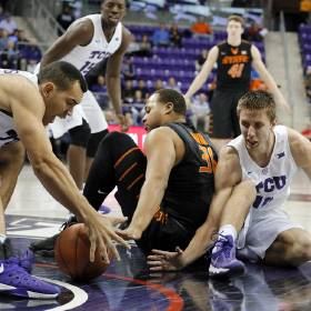 TCU's Michael Williams, left, and Vladimir Brodziansky (10), of Slovakia, compete for the ball on the court against Oklahoma State's Chris Olivier (31) in the first half of an NCAA college basketball game, Monday, Feb. 8, 2016, in Fort Worth, Texas. (AP Photo/Tony Gutierrez)
