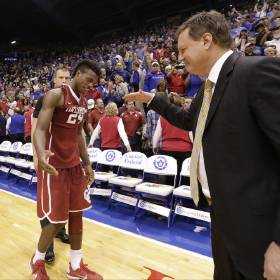 Kansas head coach Bill Self comes in to slap hands and hug Oklahoma guard Buddy Hield (24) following the Jayhawks' 109-106 triple overtime win over the Sooners. PHOTO COURTESY LAWRENCE (KAN.) JOURNAL-WORLD