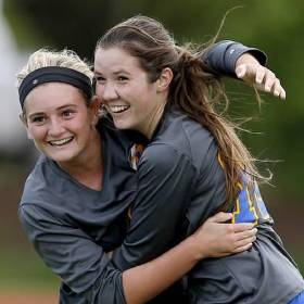 Piedmont's Kylie Pyle, right, and Kilie Swanson celebrate after Pyle's fourth goal against Heritage Hall during a girls high school soccer match last month. (Photo by Bryan Terry, The Oklahoman)